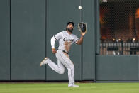 Chicago White Sox center fielder Brian Goodwin catches a fly ball by Houston Astros' Martin Maldonado during the third inning of a baseball game Friday, June 18, 2021, in Houston. (AP Photo/David J. Phillip)