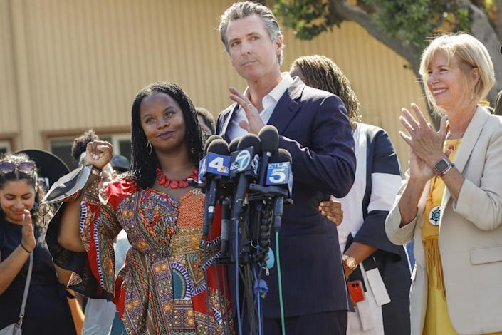 Activist Kavon Ward is brought up and recognized by Gov. Gavin Newsom