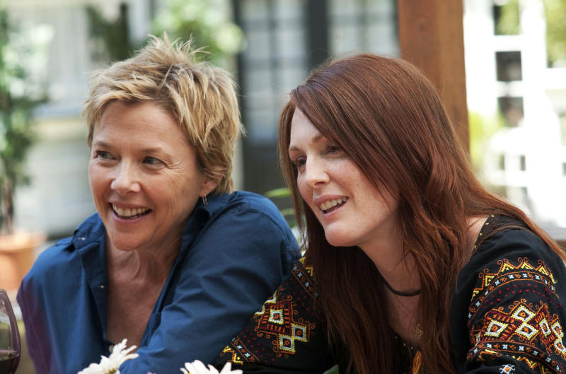 """FILE - In this publicity image released by Focus Features, Annette Bening, left, and Julianne Moore are shown in a scene from """"The Kids are All Right."""" (AP Photo/Focus Features, Suzanne Tenner, File)"""