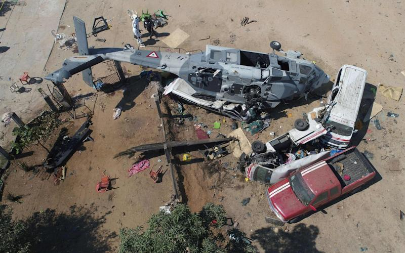 View of the military helicopter that fell on a van in Santiago Jamiltepec, Oaxaca state - AFP