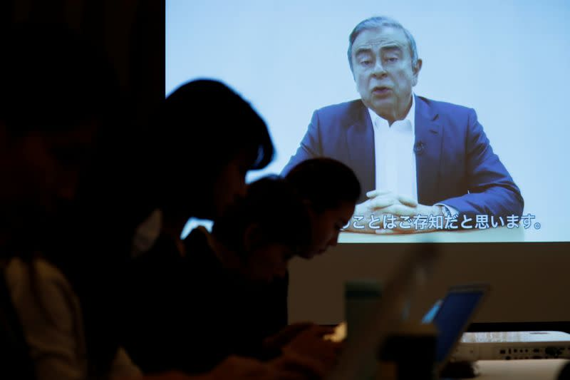 A video statement made by the former Nissan Motor chairman Carlos Ghosn is shown on a screen during a news conference by his lawyers at Foreign Correspondents' Club of Japan in Tokyo