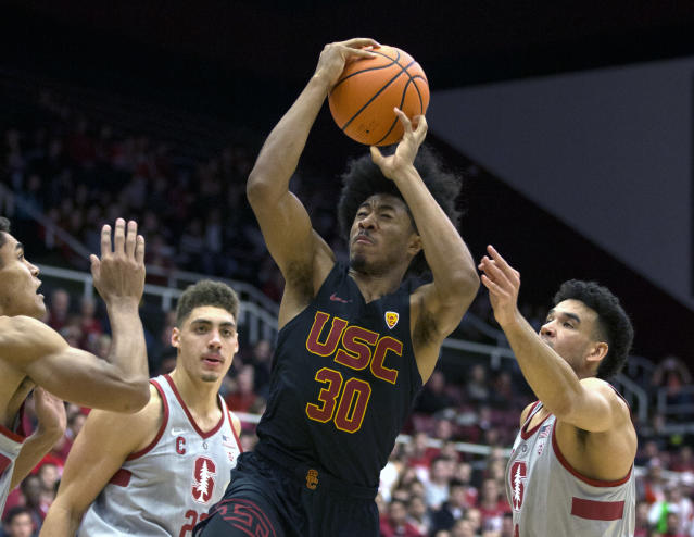 "Southern California's <a class=""link rapid-noclick-resp"" href=""/ncaab/players/126325/"" data-ylk=""slk:Elijah Stewart"">Elijah Stewart</a> drives to the basket amid Stanford defenders.  (AP Photo)"