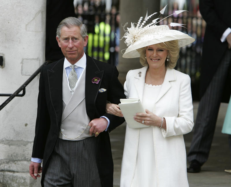 LONDON - APRIL 09: TRH Prince Charles, the Prince of Wales, and his wife Camilla, the Duchess of Cornwall, depart the Civil Ceremony where they were legally married, at The Guildhall, Windsor on April 9, 2005 in Berkshire, England. (Photo by Georges De Keerle/Getty Images)