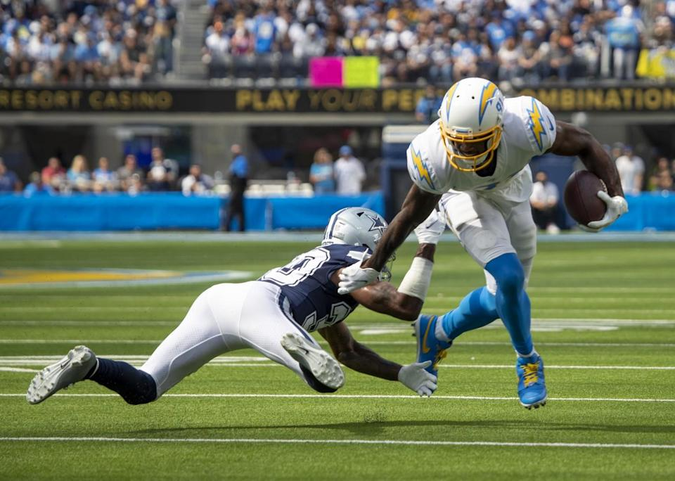 Chargers wide receiver Mike Williams avoids a tackle by Dallas Cowboys cornerback Anthony Brown.