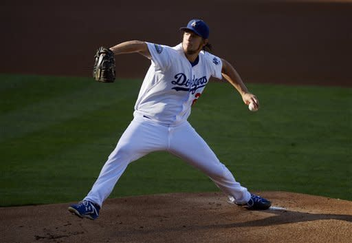 Los Angeles Dodgers starting pitcher Clayton Kershaw throws to the plate during the first inning of the Dodgers' baseball game against the San Francisco Giants, Wednesday, Oct. 3, 2012, in Los Angeles. (AP Photo/Mark J. Terrill)