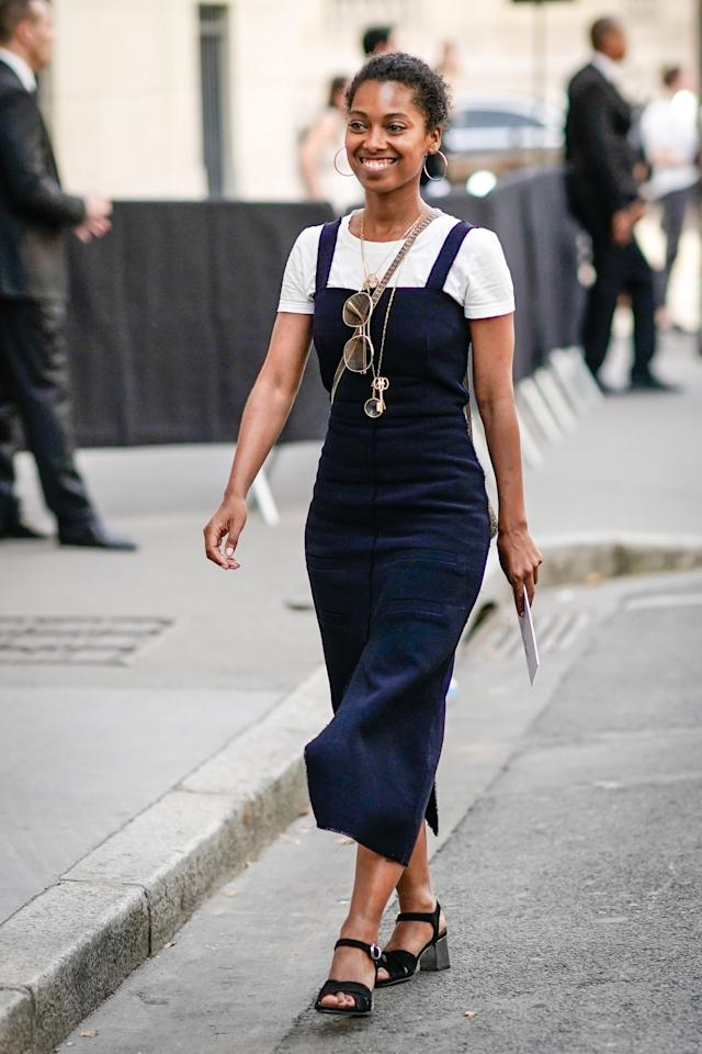 <p>Keep it classic and easy with a white tee and navy mid-length dress on top.</p>