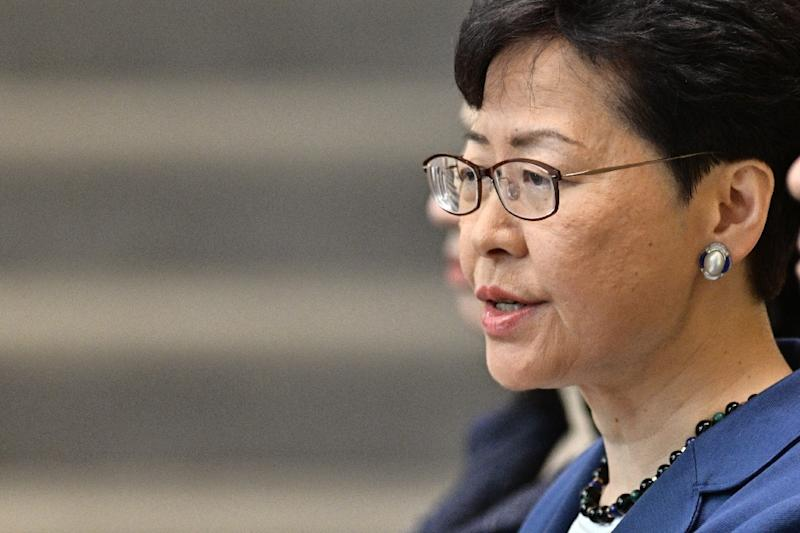Hong Kong leader Carrie Lam says safeguards are in place to ensure political cases will not be affected by the extradition law (AFP Photo/Anthony WALLACE)