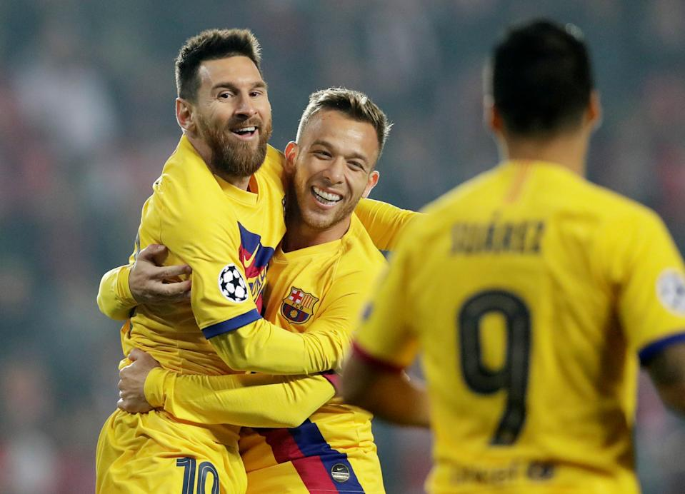 Lionel Messi (left) celebrates after scoring the opening goal in Barcelona's 2-1 win over Slavia Prague on Wednesday in the Champions League. (Reuters)