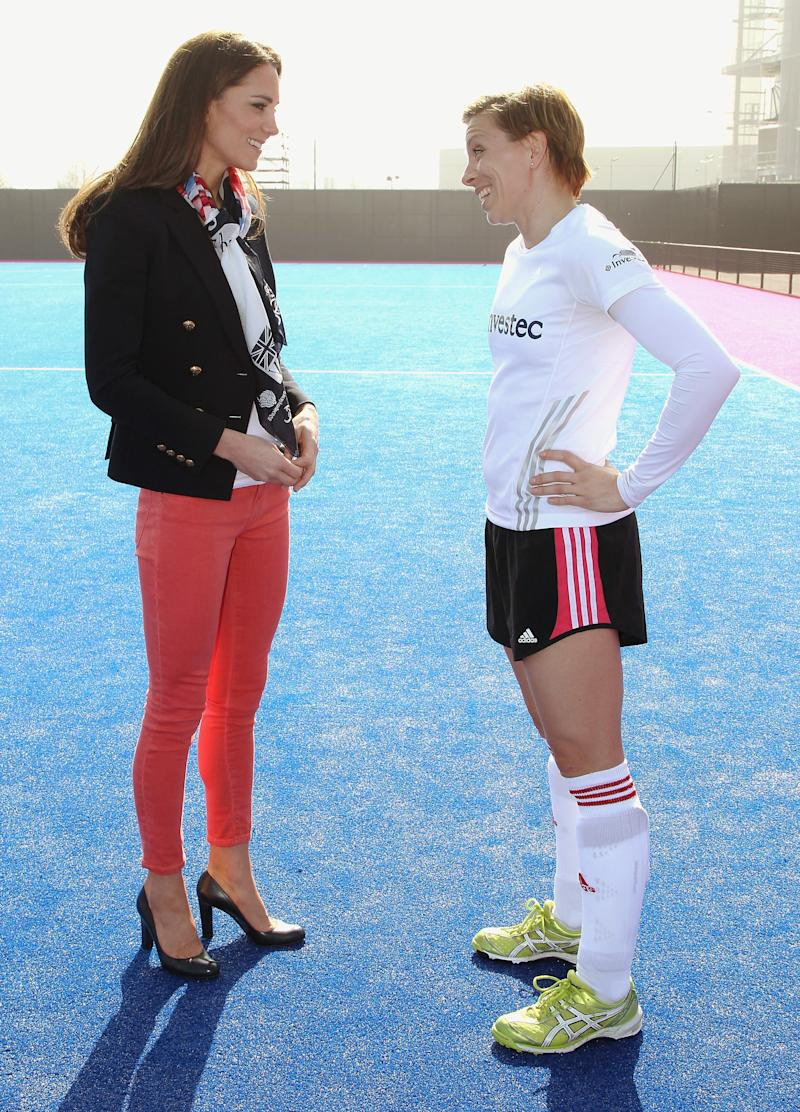 Women's Team GB hockey captain Kate Walsh and Catherine, Duchess of Cambridge chat in Olympic Park on March 15, 2012, in London. (Chris Jackson via Getty Images)