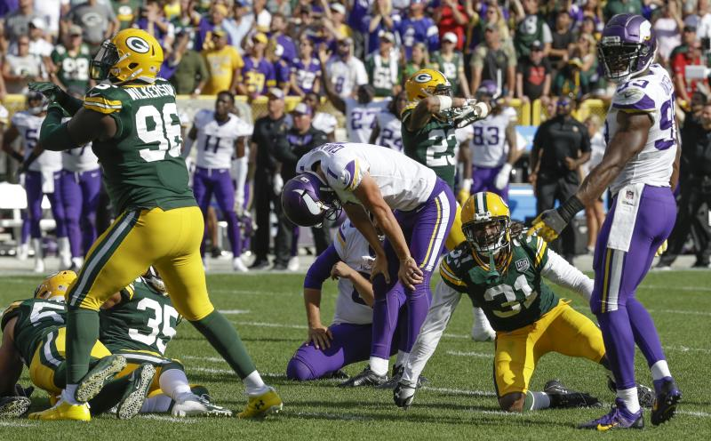 Minnesota Vikings kicker Daniel Carlson reacts after missing a field goal in the final seconds of overtime an NFL football game against the Green Bay Packers Sunday Sept. 16 2018 in Green Bay Wis. The game ended in a 29-29 tie
