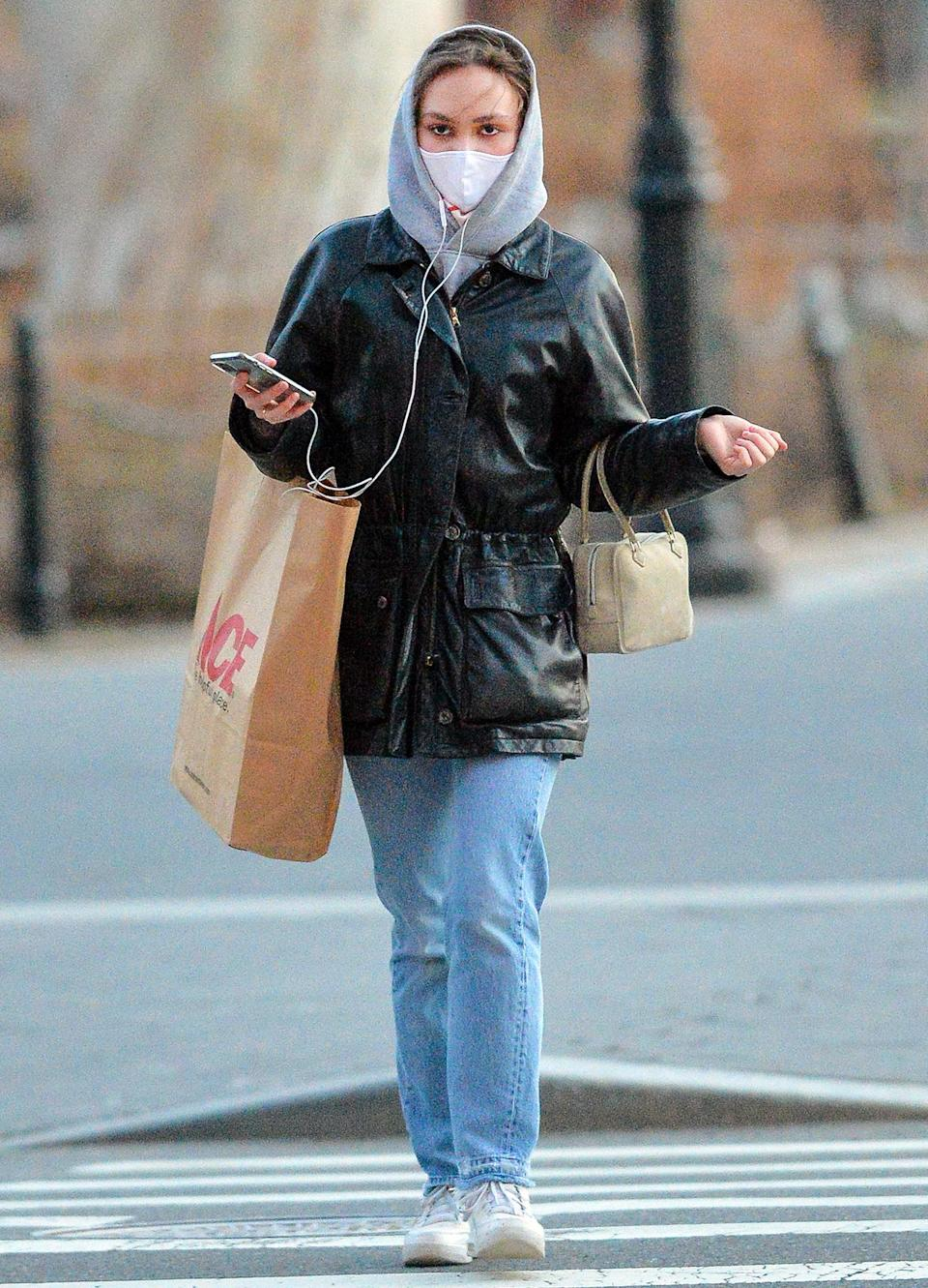 <p>Lily-Rose Depp makes a stop at Ace Hardware in N.Y.C. on Wednesday, wearing a hoodie under a leather jacket, jeans and white sneakers.</p>