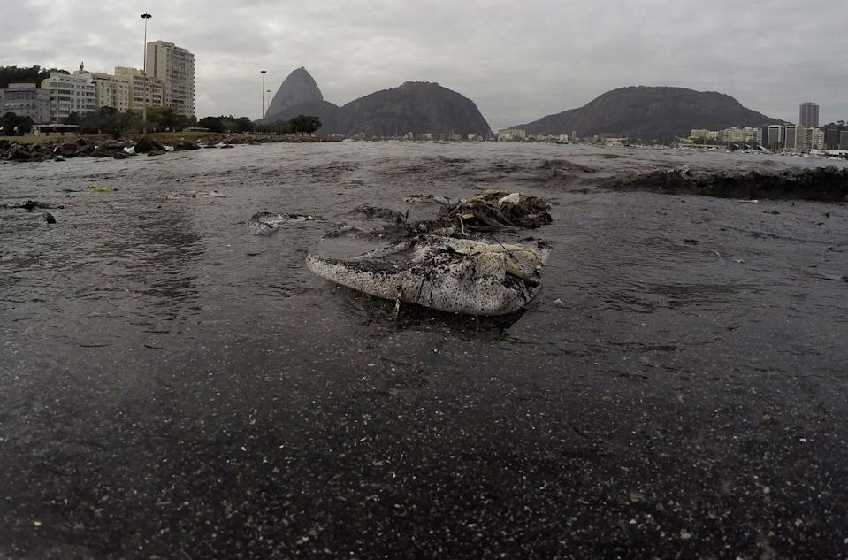 <p>Thrash floats on the water of Botafogo beach next to the Sugar Loaf mountain and the Guanabara Bay where sailing athletes will compete during the 2016 Summer Olympics in Rio de Janeiro, Brazil, Saturday, July 30, 2016. A recent investigation by Associated Press on water quality at aquatic venues for the 2016 Olympic Games in Rio de Janeiro, Brazil, has raised concerns about the risk to the health of athletes who will compete. The games start on August 5.(AP Photo/Leo Correa)</p>