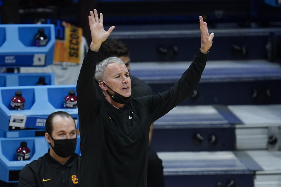USC head coach Andy Enfield watches against Kansas during the second half of a men's college basketball game in the second round of the NCAA tournament at Hinkle Fieldhouse in Indianapolis, Monday, March 22, 2021. (AP Photo/Paul Sancya)