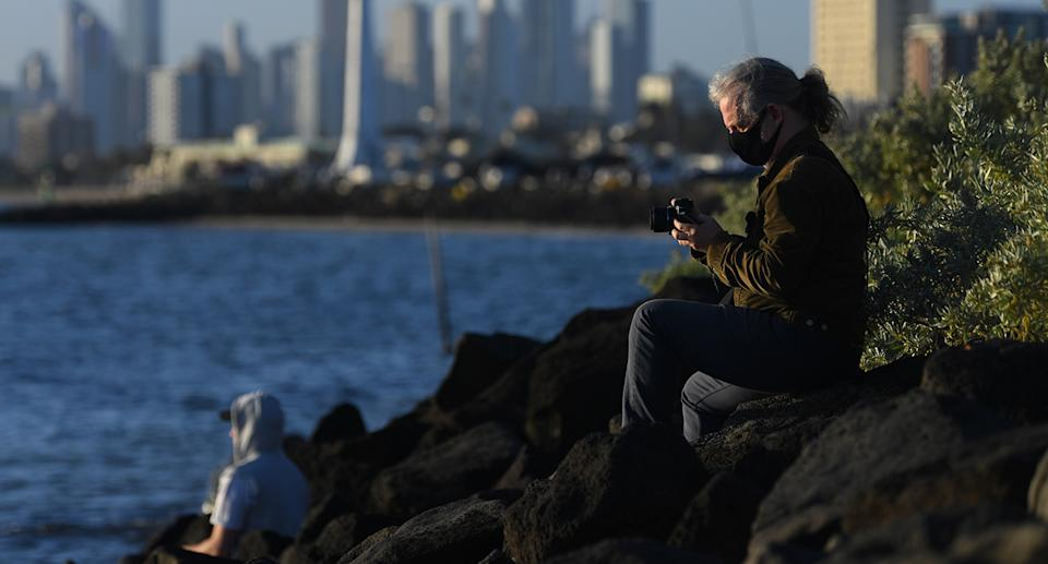 People are seen enjoying the sunshine near Elwood beach in Melbourne, Monday, September 14, 2020. Covid19 restrictions have eased in Melbourne today as Victoria recorded 35 new cases of coronavirus and seven deaths in the past 24 hours. (AAP Image/James Ross) NO ARCHIVING