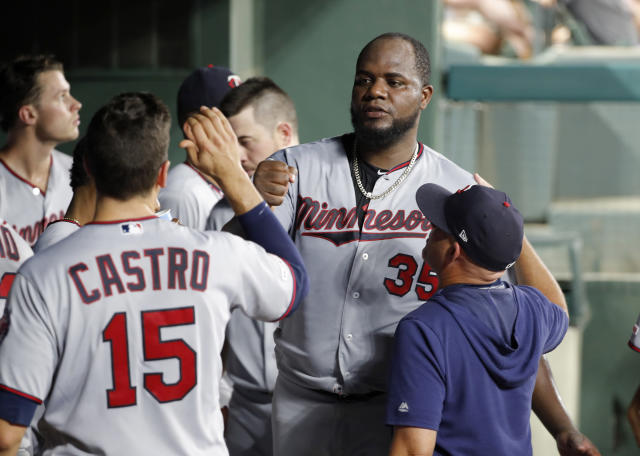 Minnesota Twins starting pitcher Michael Pineda (35) is greeted in the dugout by Jason Castro (15) and others after getting Texas Rangers' Nomar Mazara to fly out to end the top of the fifth inning of a baseball game in Arlington, Texas, Thursday, Aug. 15, 2019. (AP Photo/Tony Gutierrez)