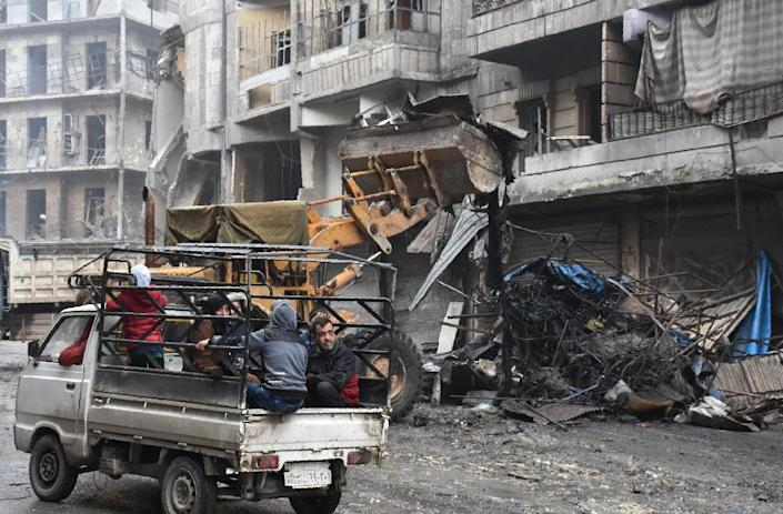The Syrian government starts to clean up areas formerly held by opposition forces in Aleppo's Shaar district (AFP Photo/George OURFALIAN)