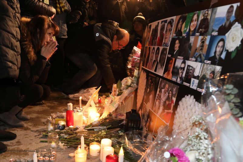 Mourners attend an outdoor vigil for the victims of a Ukrainian passenger jet which crashed in Iran, in Toronto