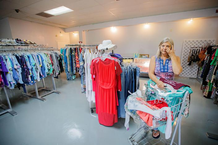 Patti Brake, 58, store manager at the Calhoun Liberty Ministry Center thrift store, wipes away tears Wednesday, July 21, 2021 as she says her faith has held her up during hardships.