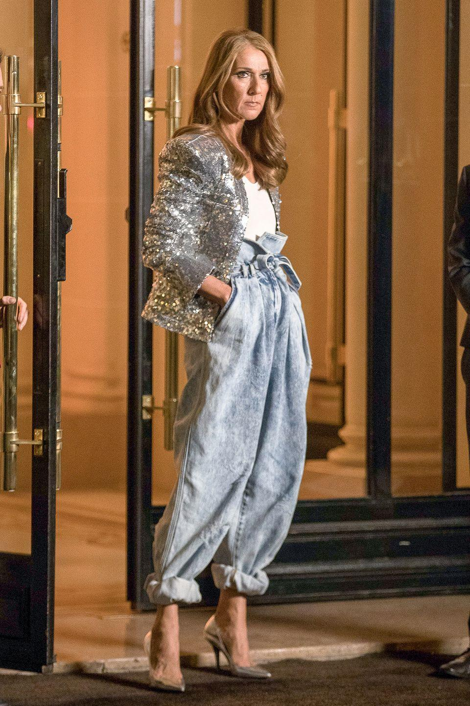 <p>Celine does Balmain in baggy denim jeans, a silver sequined blazer, and matching pumps for a night out. </p>