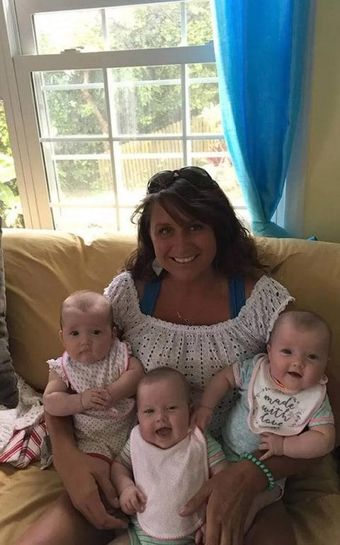 The triplets with their mother, Kate Jackson - Credit: Facebook