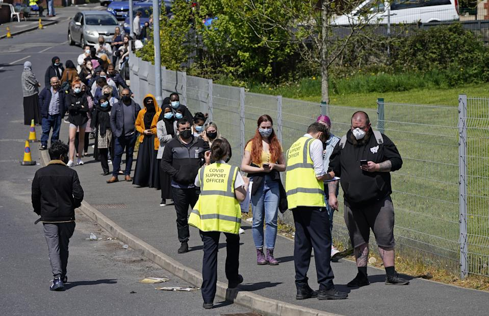 People queue for Covid-19 vaccinations at the ESSA academy in Bolton (Danny Lawson/PA) (PA Wire)