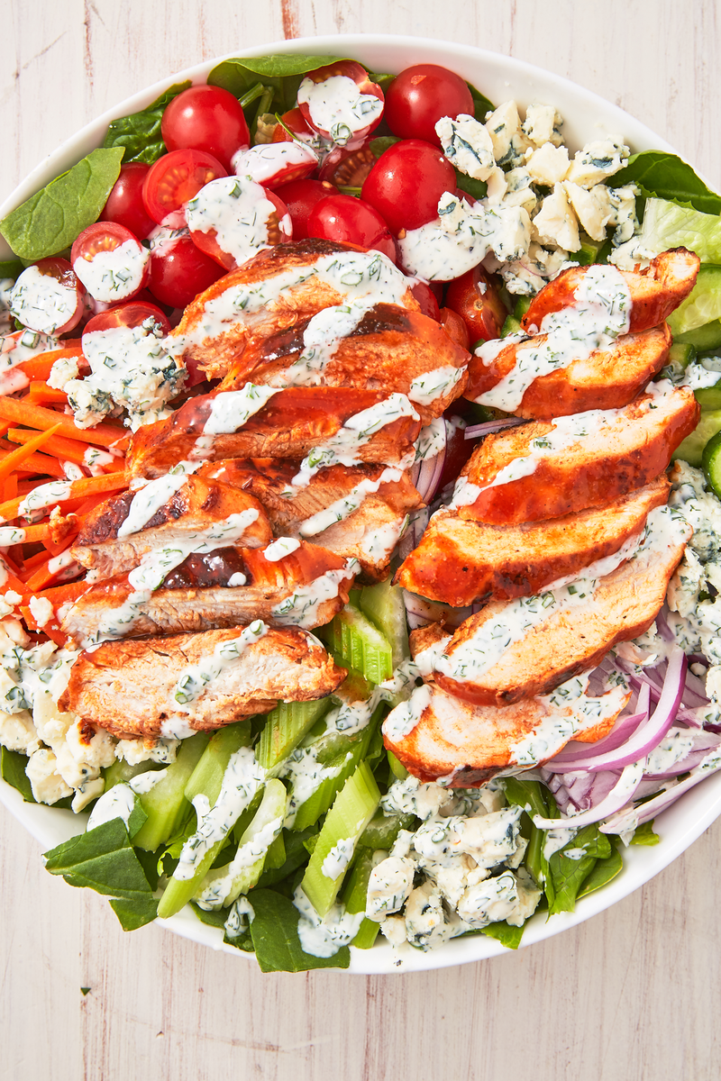 """<p>Would you think we were crazy if we wanted to eat a SALAD while watching sports? We don't even care, because this buffalo chicken salad has it all. It's the best way to eat your <a href=""""https://www.delish.com/uk/cooking/recipes/a29571609/classic-buffalo-wings-recipe/"""" rel=""""nofollow noopener"""" target=""""_blank"""" data-ylk=""""slk:buffalo chicken wings"""" class=""""link rapid-noclick-resp"""">buffalo chicken wings</a>, covered in a homemade ranch dressing, with all of our favourite sides. Bonus, no saucy orange fingers! </p><p>Get the <a href=""""https://www.delish.com/uk/cooking/recipes/a34093058/easy-buffalo-chicken-salad-recipe/"""" rel=""""nofollow noopener"""" target=""""_blank"""" data-ylk=""""slk:Buffalo Chicken Salad"""" class=""""link rapid-noclick-resp"""">Buffalo Chicken Salad</a> recipe.</p>"""
