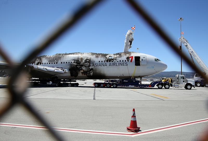 The wrecked fuselage of Asiana Airlines flght 214 sits in a storage area at San Francisco International Airport on July 12, 2013 in California (AFP Photo/Justin Sullivan)