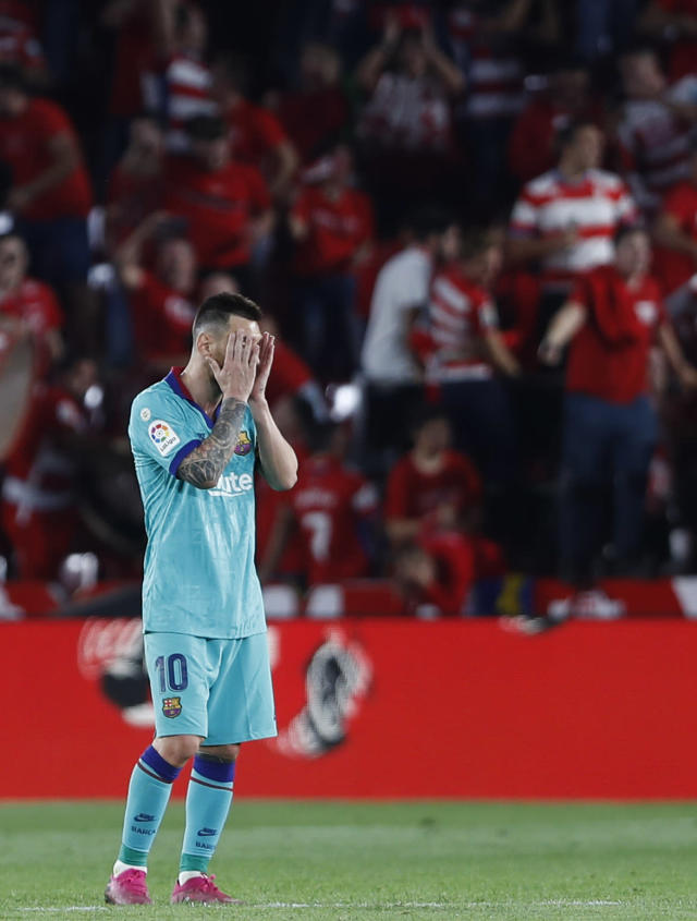 Barcelona's Messi reacts during the Spanish La Liga soccer match between Barcelona and Granada at the Los Carmenes stadium in Granada, Spain, Saturday, Sep. 21, 2019. Ganada won 2-0.(AP Photo/Miguel Morenatti)