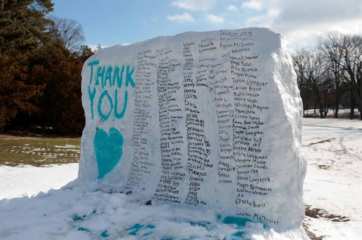 A boulder on the campus of Michigan State University is painted with the names of assault victims of Larry Nassar. (Photo: Rebecca Cook / Reuters)