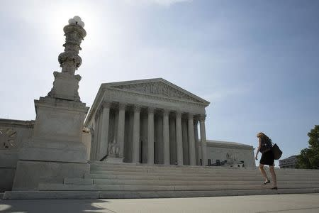 A woman walks to the Supreme Court in Washington