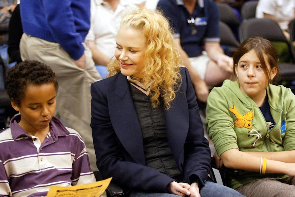 One of the few times Nicole Kidman was photographed with her children with Tom Cruise, Connor and Isabella Cruise, was at a basketball game in December 2004. (Photo: Matthew Simmons/Getty Images)