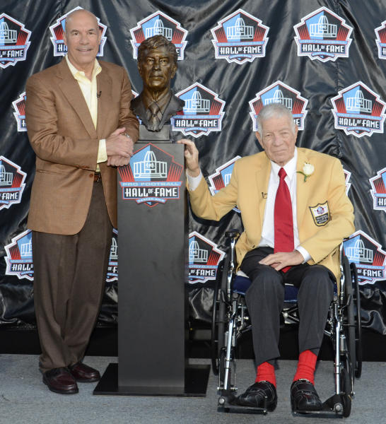 FILE - In this Aug. 6, 2011 photo provided by the Pro Football Hall of Fame, Ed Sabol, right, poses with a bust of himself and his presenter Steve Sabol during induction ceremonies at the Pro Football Hall of Fame, in Canton, Ohio. NFL Films President Steve Sabol has died from brain cancer. He was 69. The NFL said Sabol died Tuesday, Sept. 18, 2012, 18 months after he was diagnosed with a tumor on the left side of his brain. Sabol started working with his father Ed, NFL Films' founder, in 1964, and their innovations revolutionized sports broadcasting and helped make the NFL the country's most popular sport.(AP Photo/Pro Football Hall of Fame, Shawn Wood)