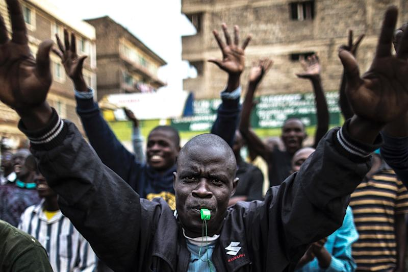 Opposition supporters march through Nairobi's Mathare slum, shouting 'Uhuru must go' (AFP Photo/MARCO LONGARI)
