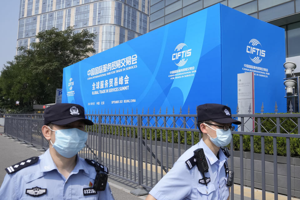 Chinese police officers patrol outside the venue for the China International Fair for Trade in Services (CIFTIS) in Beijing on China, Thursday, Sept. 2, 2021. Chinese and foreign enterprises are expected to showcase their latest technology and services during the annual China International Fair for Trade in Services this week. (AP Photo/Ng Han Guan)