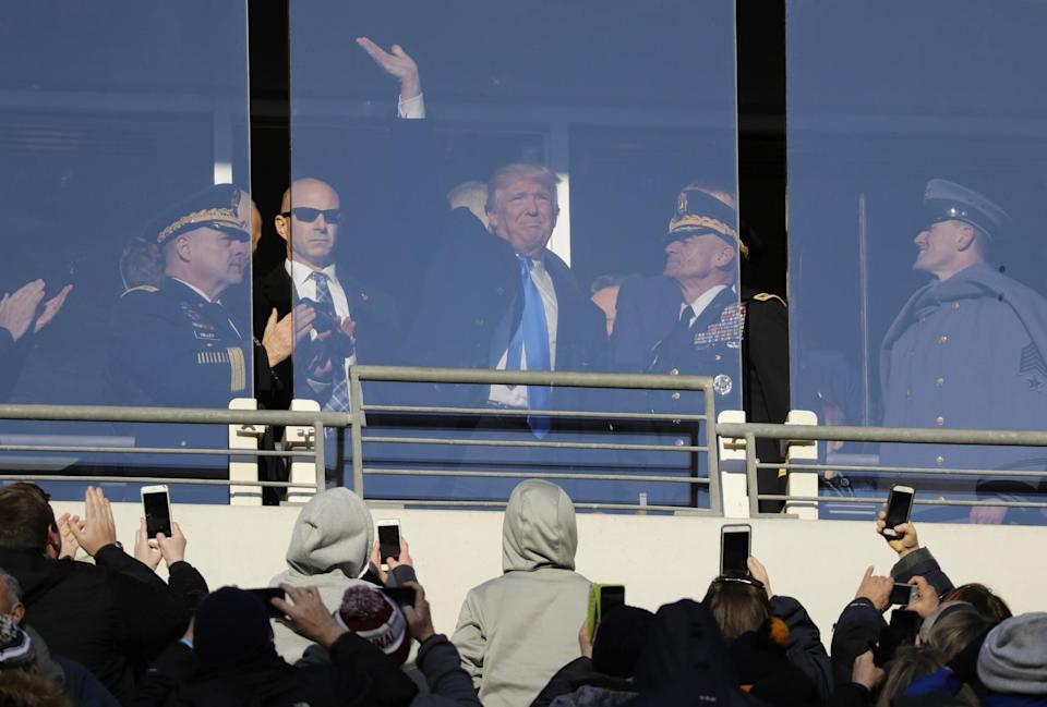 President-elect Donald Trump acknowledges spectators during the first half of the Army-Navy NCAA college football game in Baltimore, Saturday, Dec. 10, 2016. (AP Photo/Patrick Semansky)