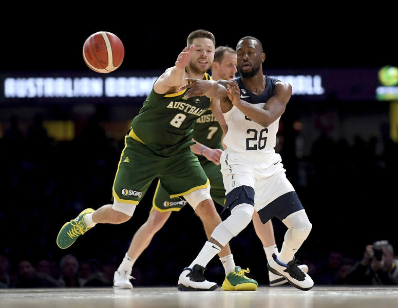 United States' Kemba Walker, right, and Australia's Matthew Dellavedova, left, battle for the ball during their exhibition basketball game in Melbourne, Thursday, Aug. 22, 2019. (AP Photo/Andy Brownbill)