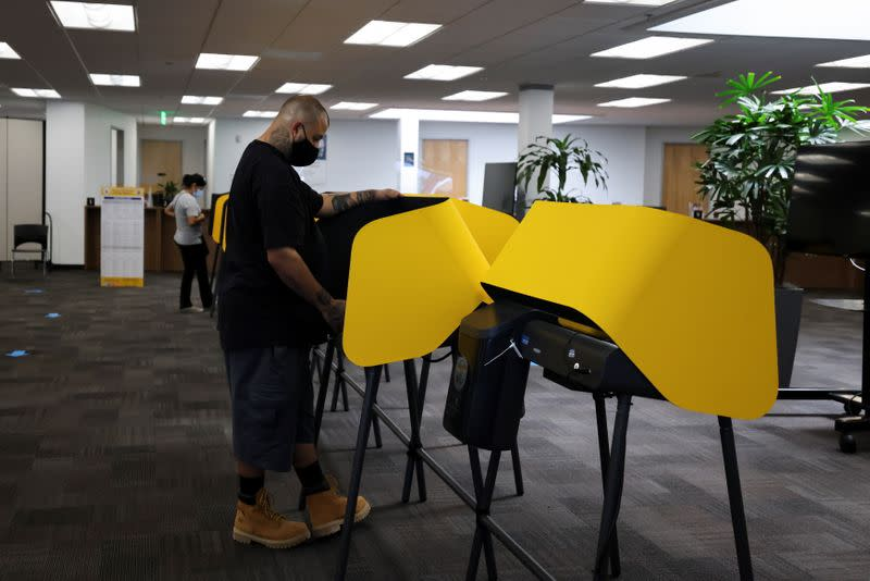 Michael Gonzales, 35, votes at the Uber Hub polling station