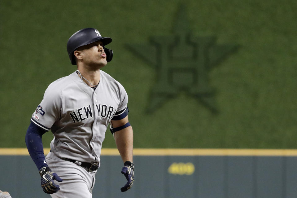 New York Yankees' Giancarlo Stanton rounds the bases after a home run during the sixth inning in Game 1 of baseball's American League Championship Series against the Houston Astros Saturday, Oct. 12, 2019, in Houston. (AP Photo/Eric Gay)