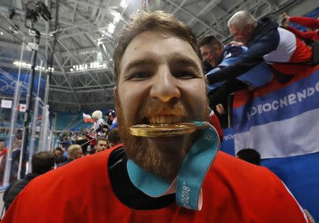 Ice Hockey - Pyeongchang 2018 Winter Olympics - Men Final Match - Olympic Athletes from Russia v Germany - Gangneung Hockey Centre, Gangneung, South Korea - February 25, 2018 -Nikita Nesterov, an Olympic Athlete from Russia, poses with his gold medal. REUTERS/Kim Kyung-Hoon