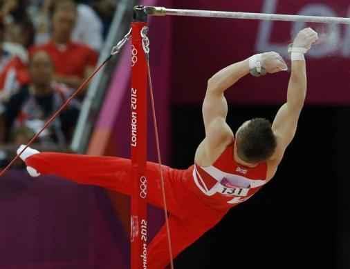 Sam Oldham of Britain falls from the horizontal bar during the men's gymnastics team final in the North Greenwich Arena during the London 2012 Olympic Games July 30, 2012.