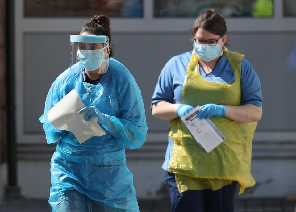 A nurse prepares to take a sample at a COVID 19 testing centre in the car park of the Bowhouse Community Centre in Grangemouth as the UK continues in lockdown to help curb the spread of the coronavirus.