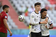 Germany's Kai Havertz celebrates with Serge Gnabry, right, after scoring his side's third goal during the Euro 2020 soccer championship group F match between Portugal and Germany at the Football Arena stadium in Munich, Germany, Saturday, June 19, 2021. (Philipp Guelland/Pool via AP)