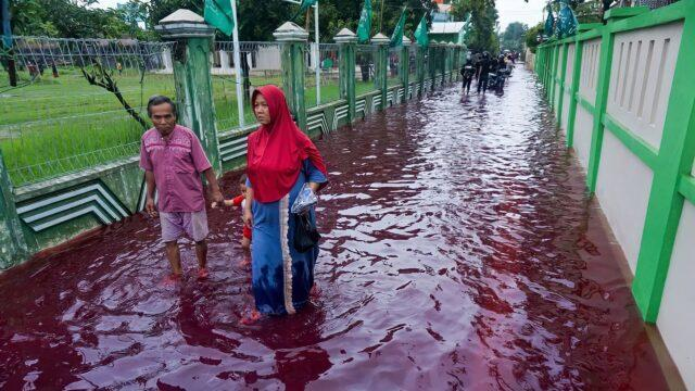 Locals struggling with the red flood water