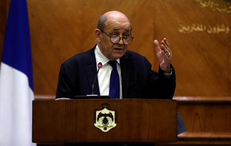 FILE PHOTO: French Foreign Minister Jean-Yves Le Drian gestures during a joint news conference with Jordanian Foreign Minister Ayman Safadi, in Amman, Jordan, January 13, 2019. REUTERS/Muhammad Hamed