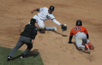 Baltimore Orioles' Dwight Smith Jr. (35) steals second base as the throw to New York Yankees second baseman Gleyber Torres goes wide during the sixth inning of a baseball game, Saturday, March 30, 2019, in New York. (AP Photo/Julie Jacobson)