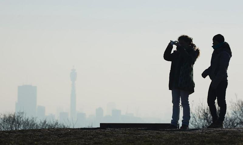 People look out from Parliament Hill towards central London during a 'very high' pollution alert in January.