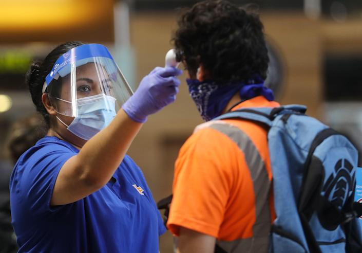 On Monday, the government will stop conducting enhanced screening of passengers on inbound international flights for the coronavirus. (Mario Tama/Getty Images)