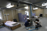 Workers install a sink at field hospital for COVID-19 patients at the 11th Army Region base in Bangkok, Thailand, Friday, July 2, 2021. As Thailand faces growing numbers of COVID-19 cases and related deaths during a devastating third wave of the coronavirus, there are concerns that it will face a shortage of hospital beds, intensive care units and ventilators for seriously ill patients. (AP Photo/Sakchai Lalit)