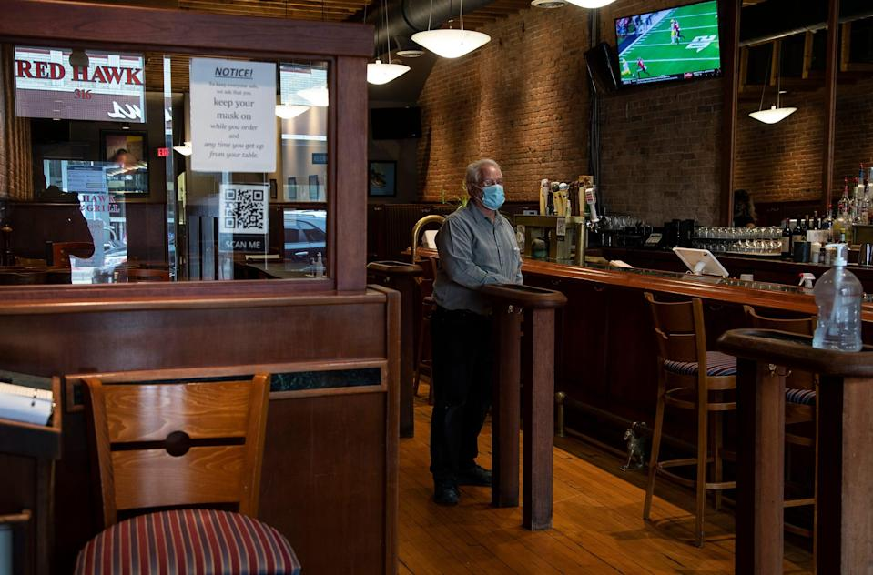 Roger Hewitt, owner of Red Hawk Bar and Grill poses for a photo inside of the restaurant in Ann Arbor, Friday, Oct. 30, 2020.