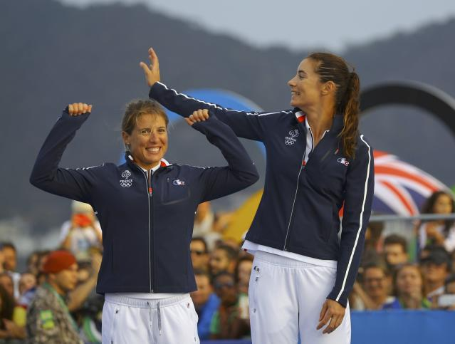 2016 Rio Olympics - Sailing - Victory Ceremony - Women's Two Person Dinghy - 470 - Victory Ceremony - Marina de Gloria - Rio de Janeiro, Brazil - 18/08/2016. Camille Lecointre (FRA) of France and Helene Defrance (FRA) of France celebrate. REUTERS/Brian Snyder FOR EDITORIAL USE ONLY. NOT FOR SALE FOR MARKETING OR ADVERTISING CAMPAIGNS.